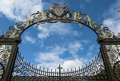 Ornate Gate Arch. Highly decorative golden colour gates of Warrington town Hall, UK Stock Photo