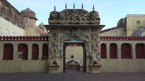Ornate gate arch with beautiful lion reliefs in Jaipur, India. Ornate gate arch with beautiful lion reliefs in Jaipur,Rajasthan, India stock video footage