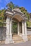 Ornate gate with ironwork and lush garden, Xiamen, China Stock Photo