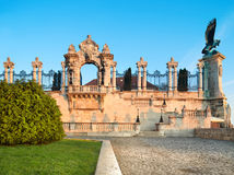 Ornate gates into Buda Castle in Budapest at dawn. Ornate gates into Buda Castle in Budapest early in the morning. Panoramic image, focus on the gate Royalty Free Stock Photography