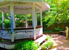 Ornate Gazebo. Ornate white gazebo in fancy garden Stock Images