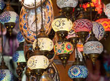 Ornate glass lights at market stall Stock Image
