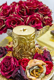 Ornate gold candle with red roses Royalty Free Stock Photography