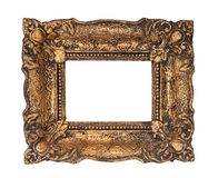 Ornate golden baroque frame isolated on the white background. Studio shoot Royalty Free Stock Photography