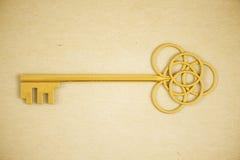 Ornate golden key. On light background. 3D Rendering Stock Photo
