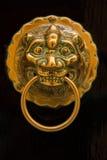 Ornate golden lion head door knocker. In Malta Stock Photos