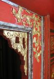 Ornate golden trim around a doorway in Vietnam royalty free stock images