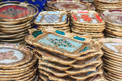 Ornate golden trivets and tablets Royalty Free Stock Photos