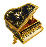 Ornate grand piano keys. Photo of a beautifully decorated gold piano encrusted with diamonds and flowers on the lid Stock Images
