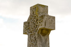 Ornate gravestone cross. Ornately carved gravestone cross in cemetery Royalty Free Stock Photography