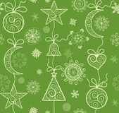 Ornate green background with golden lacy hanging baubles for winter holiday. Ornate green wallpaper with golden lacy hanging baubles for winter holiday Stock Photography