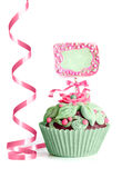 Ornate green-pink cupcake on white background Stock Photo