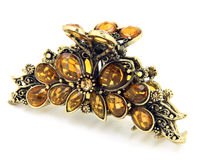Ornate Hair Clip. Isolated on white ornate, victorian style gold and rhinestone hair clip Stock Image
