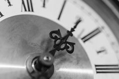 Ornate Hand on Face of Clock with Roman Numerals Stock Images