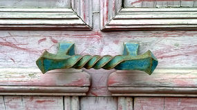 Ornate handle on door Stock Photo