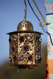 Ornate hanging lantern. Golden buddhist jeweled hanging lantern Stock Image