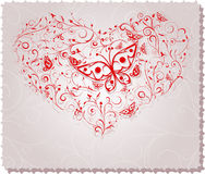 Ornate heart. Ornate greeting card with butterflies Stock Image