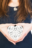Ornate heart in female hands Royalty Free Stock Photos