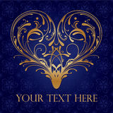 Ornate Heart. Ornate golden filigree heart on royal blue fancy background Stock Image