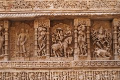 Ornate Indian Carvings. Ornate stone carved walls lining the 11th century step well at Patan, Gujarat, India. Became a UNESCO world Heritage Site in 2014 Royalty Free Stock Photos