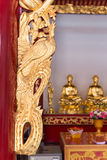 Ornate and intricate, hand carved, gold framework on an altar at Stock Photo