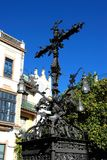 Ornate iron cross, Seville, Spain. Ornate iron cross and lanterns in the Plaza Santa Cruz, Seville, Seville Province, Andalusia, Spain, Western Europe stock images