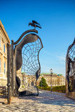 Ornate iron gate with raven on Buda Castle grounds in Budapest Stock Photography