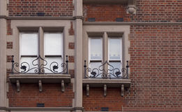 Ornate Iron Railing with Window. Stock Photo