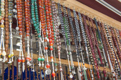 Ornate jewelry hanging at market stall Royalty Free Stock Photo
