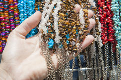 Ornate jewelry hanging at market stall Royalty Free Stock Photography