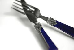Ornate Knife and Fork. Beautiful crossed antique knife and fork with ornate decoration Stock Photography