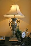 Ornate Lamp. Ornate bronze lamp with silk shade next to Royalty Free Stock Photos