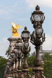 Ornate lampposts on Alexander III bridge in Paris Stock Photography