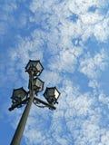 Ornate Lamps Against Blue Sky Stock Photo