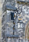 Ornate lantern on a stone wall Royalty Free Stock Image