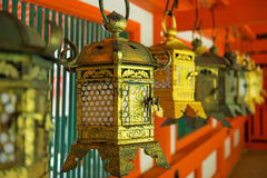 Ornate lanterns at Kasuga Grand Shrine. Detail of a row of ornate gold lanterns, donated by worshipers, at the red Kasuga Grand Shrine in the city of Nara, Japan Stock Images