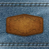 Ornate leather label. With copyspace on denim background Royalty Free Stock Photo