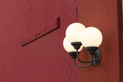 Ornate light fixture on the side of a building Stock Image