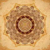 Ornate mandala and zodiac circle with horoscope signs on aged paper background. Royalty Free Stock Photography