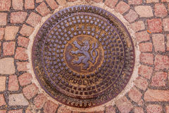 Ornate manhole cover with Bohemian coat of arms  lion Royalty Free Stock Photography