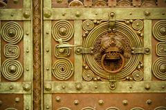 Ornate Metal Door with Knocker. Detail of an ornate metal door with knocker in Freiburg, Germany Royalty Free Stock Images