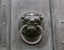 Ornate metal monster head door knocker Royalty Free Stock Image