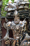 Ornate metal statue of a knight at arms Stock Photo