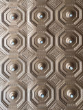 Ornate, Metalic Patterned Ceiling. An ornate patterned metallic ceiling featuring small light globes stock photos