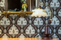 Ornate mirror ,lamp and vintage table Royalty Free Stock Image