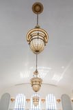 Ornate Old Lamps Hanging from White Ceiling Royalty Free Stock Photo