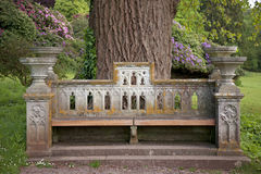 Ornate old stone seat Stock Images