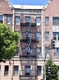 Ornate architecture. An ornate older building with a fire escape Royalty Free Stock Photos