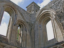 Ornate outdoor stonework. A view of some of the ornate outdoor stonework and facade found at the Glastonbury Abbey, Somerset, England Royalty Free Stock Photos