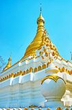 The ornate pagoda of U Min Thonze Temple, Sagaing. The ornate pagoda of U Min Thonze Temple with gilt stucco decorations and carved metal flowers, Sagaing stock photo